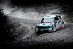 WRC Mini cornering and kicking up dirt